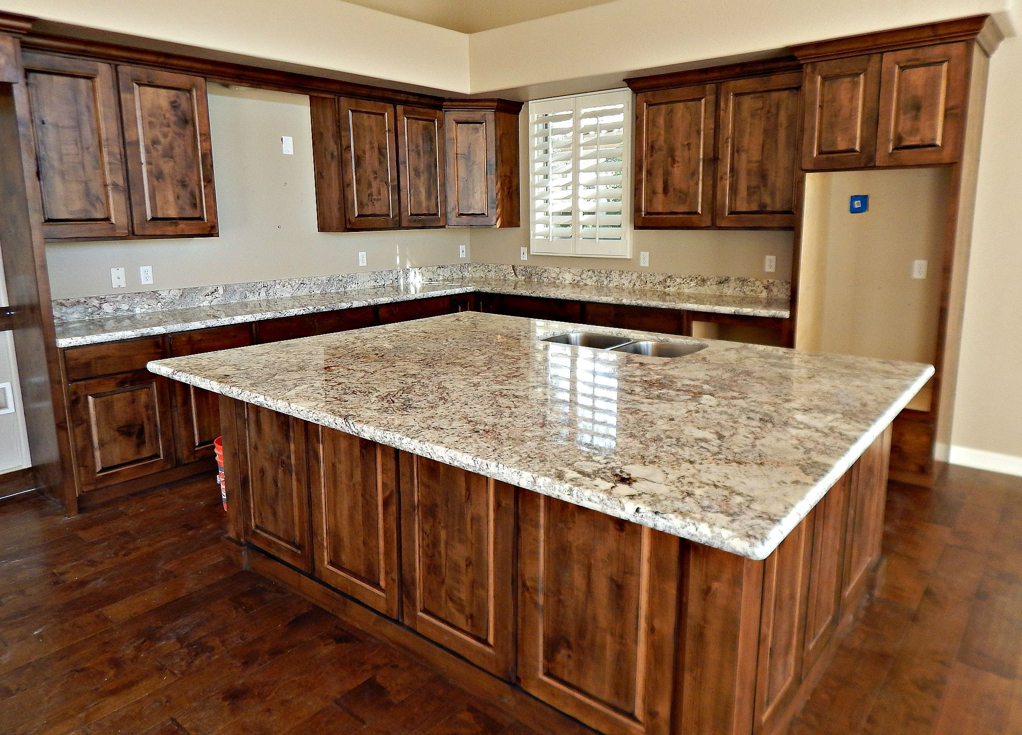 White springs granite countertop remodel with half moon edge and