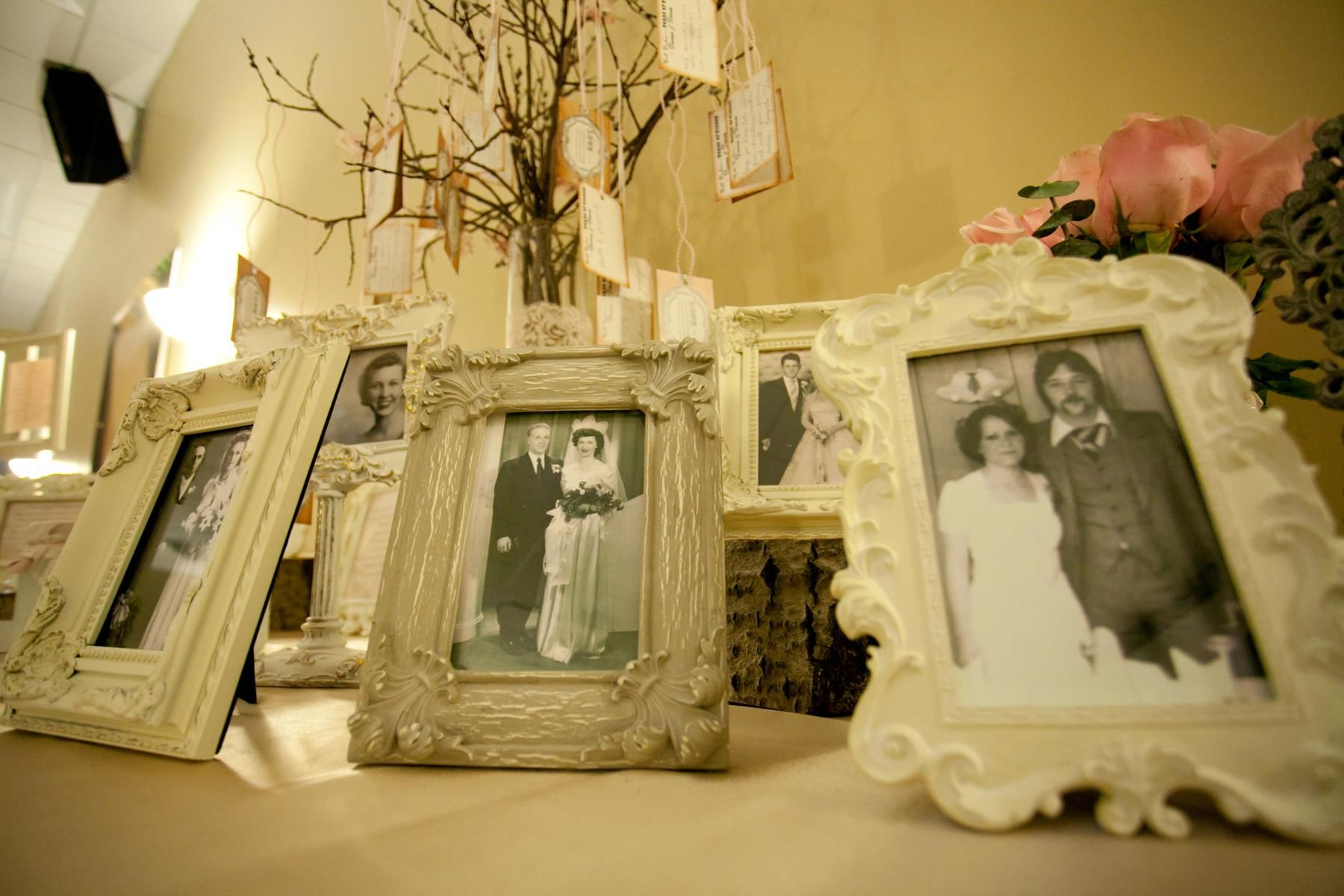 Family photo wedding reception display