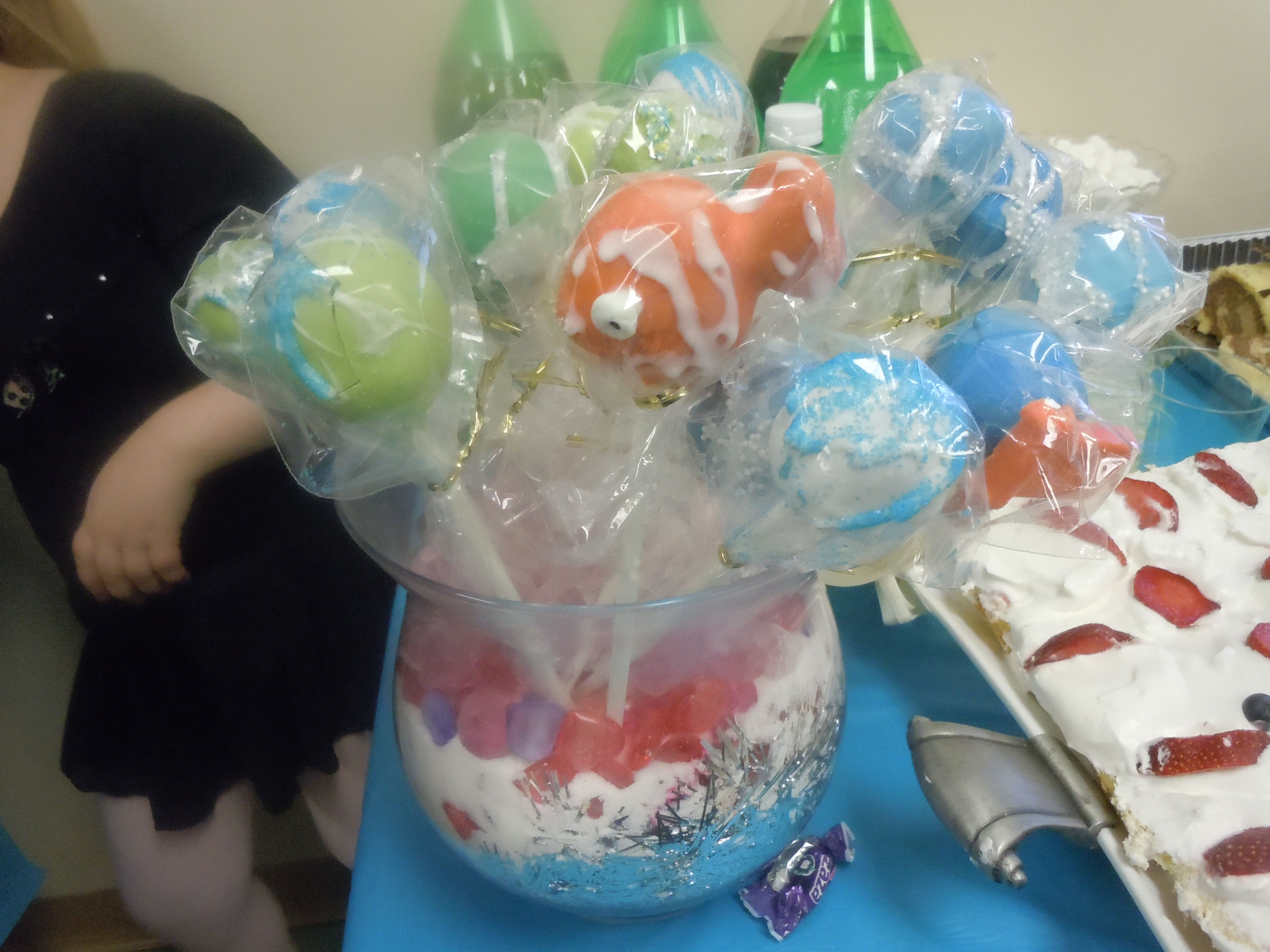 upclose of under the sea themed cake pop bouquet for a gir's bat mitzvah. it was half gone with in 10 minuets of delivering there were also 15 fish bowl pops which whent first. #cakepopbouquet