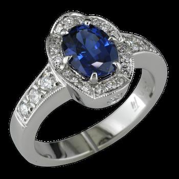 Ladies white gold sapphire and diamond ring created by Faini Designs Jewelry Studio.