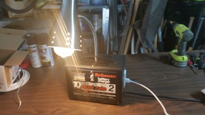 Desk lamp and phone charger repurpose ..would make a great gift for mechanic .... $150.00....904.669.0361