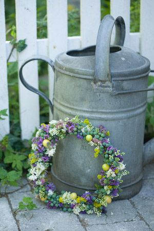 Old Watering Can...with a floral wreath.
