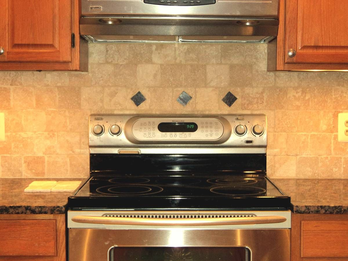 Backsplash to go with my baltic brown granite countertops for Kitchen backsplash ideas with brown cabinets