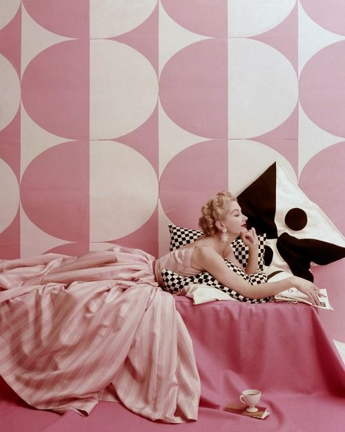 "vogue:  We're reaching for our you-know-what-colored glasses to keep things in soft focus and thinking pink.Lisa Fonssagrives in ""Spice Pinks to Summer In,"" photographed by Richard Rutledge, Vogue, April 15, 1952.See more of all things pink from the Vogue Archives on Vogue.com."