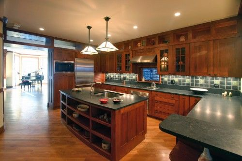 Soapstone counter tops. Arts & crafts style cabinetry. Perfect for our bungalow!