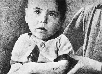 Although mothers tried desperately to hide and protect their children, few as young as this child, tattooed with the number 23141, survived Auschwitz. In the concentration camps, work provided the only hope of survival, a possibility foreclosed to the very young and the elderly. As Auschwitz moved into its final, extermination-camp phase, some children, especially twins, escaped the gas chambers upon arrival only to be subjected to cruel medical experiments.