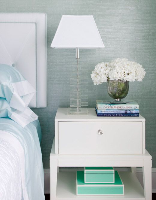 Love the calm color palette, the lucite lamp, the side tables, the boxes....this is so pretty! By Patricia Fisher Design