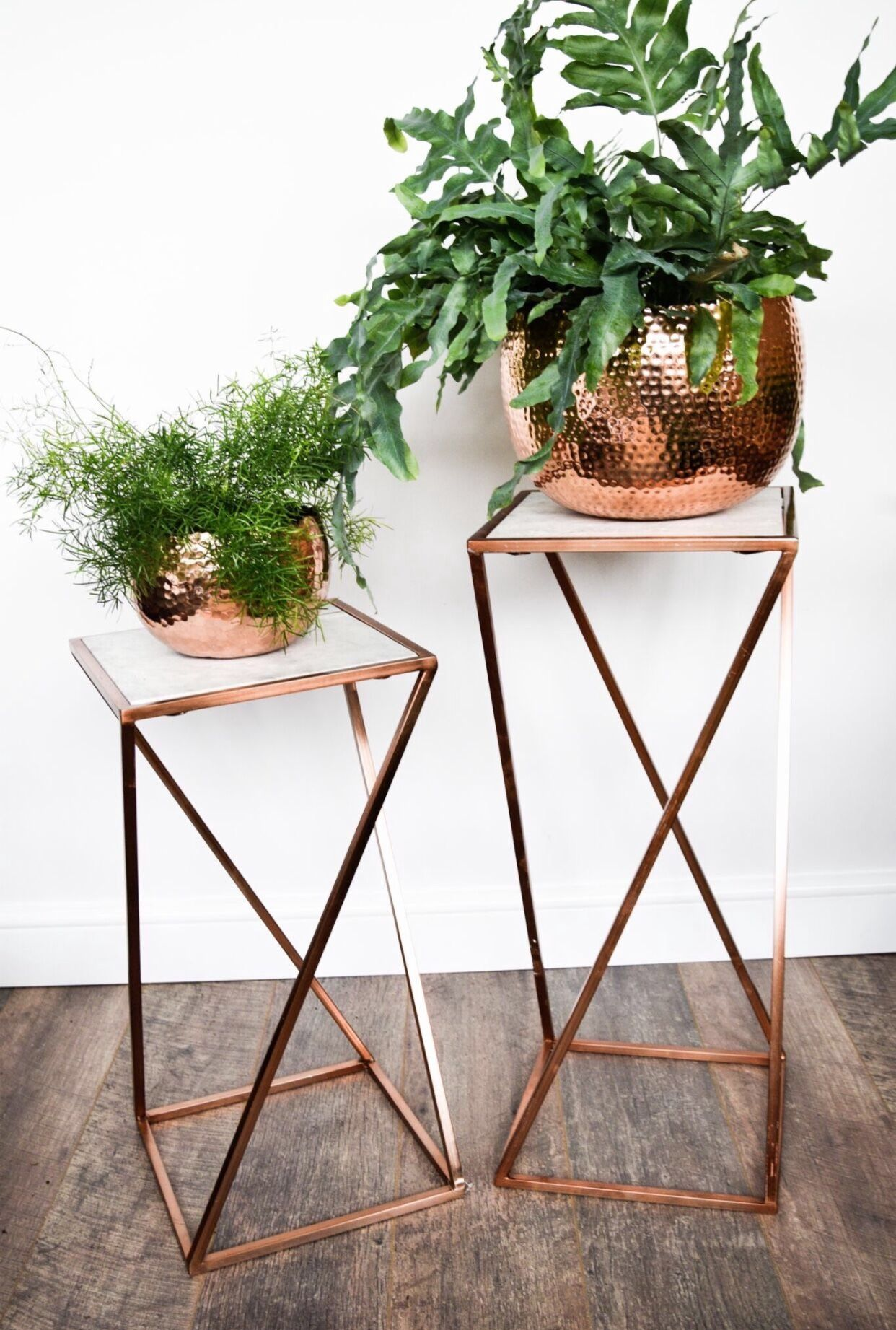 Hammered plant pots and marble top table luxury home