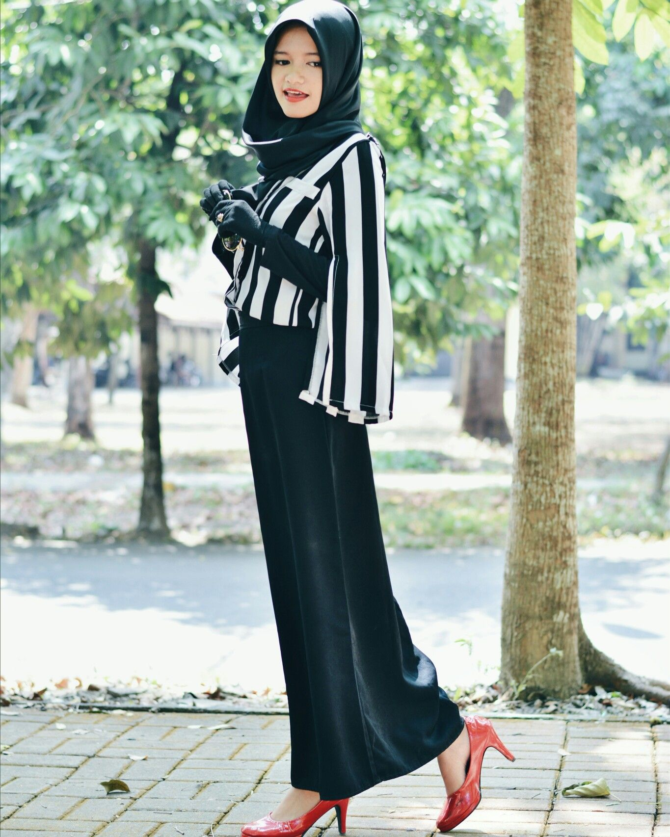Trying to look classic with black Stripes top black skirt black hijab