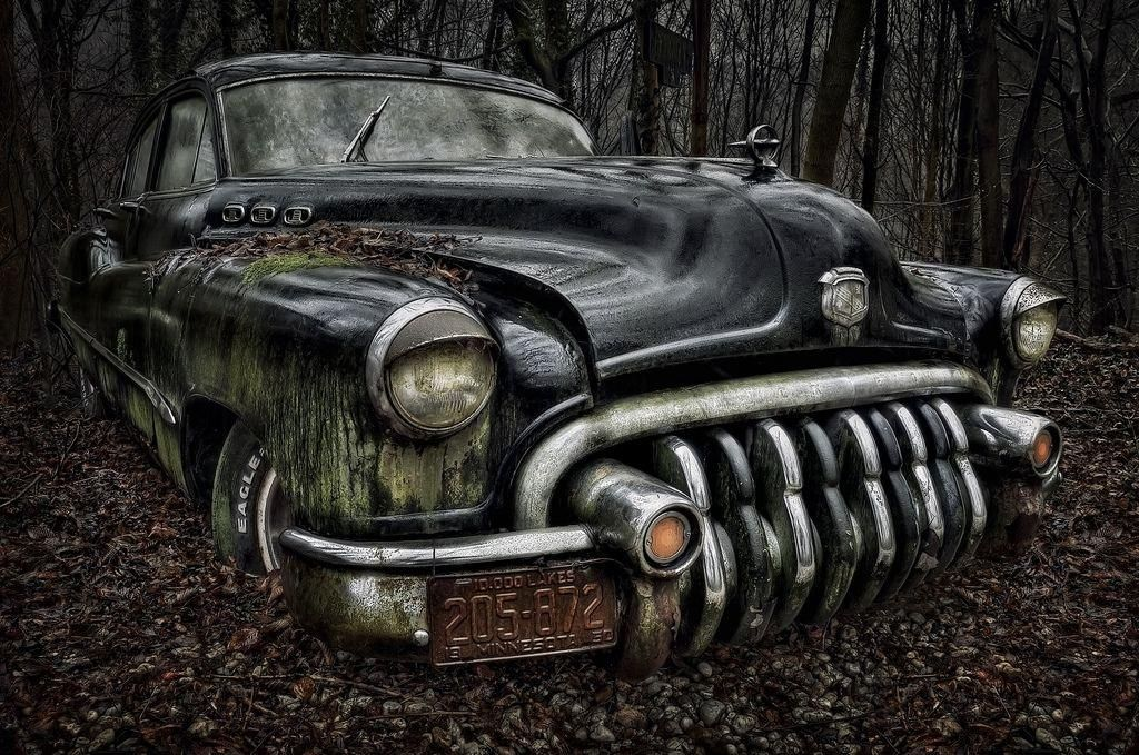 6 Haunting Photographs Of Abandoned Vintage Cars Lying In A Forest