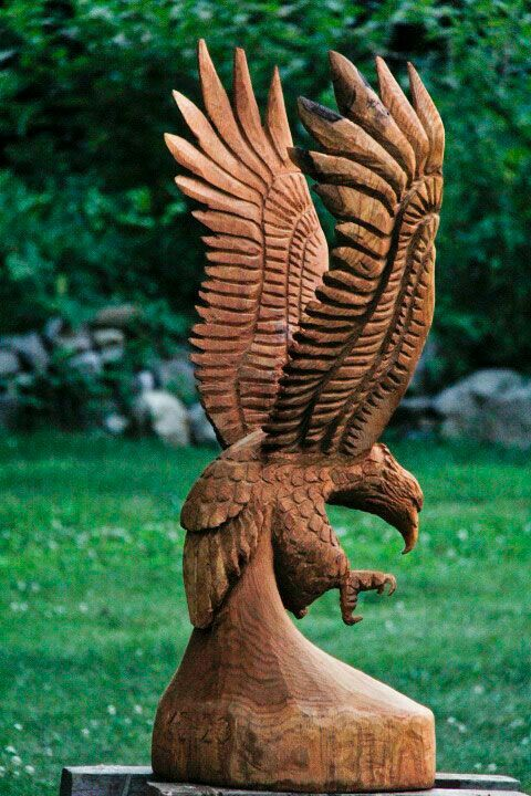 Eagle in flight chainsawwoodcarvings amazing