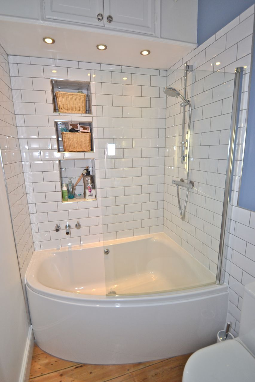 Simple white small bathroom design with corner bath tub and white ceramic tiles walls and glass cabin idea use j k to navigate to previous and next images