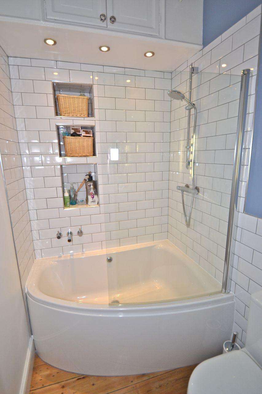 Simple White Small Bathroom Design With Corner Bath Tub And White