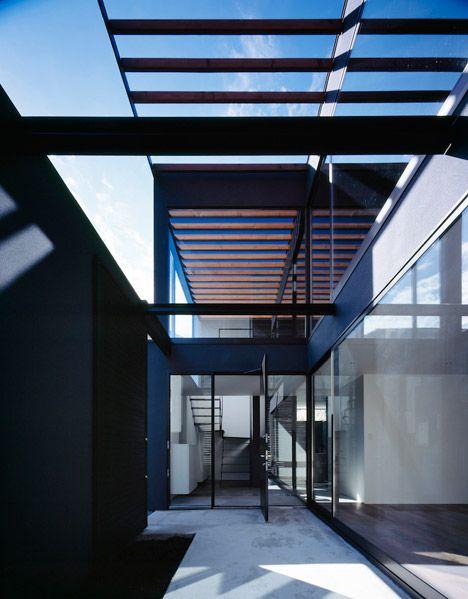 Trellis shades courtyard of Pergola house by Apollo Architects