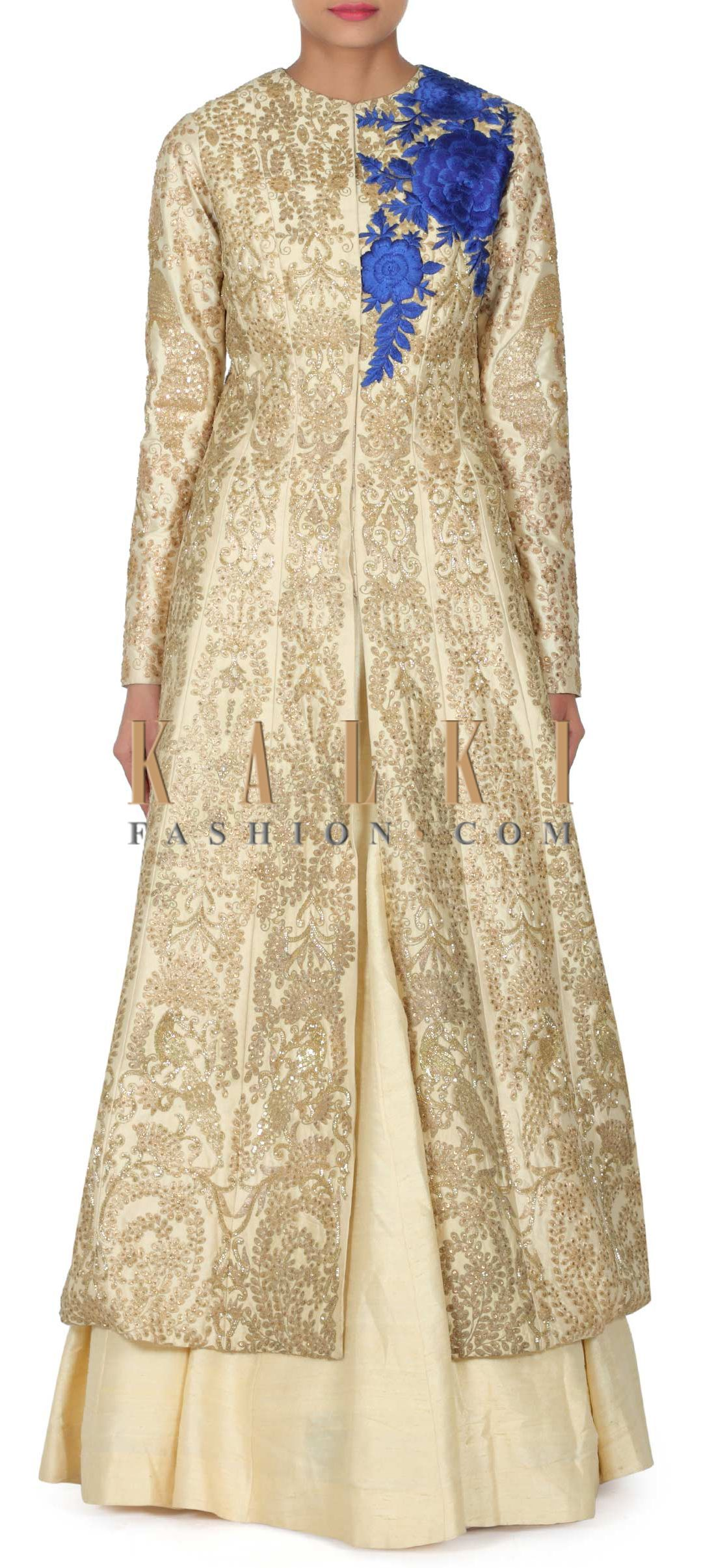 d9dd7d493 Buy this Cream lehenga matched with long jacket blouse only on Kalki ...