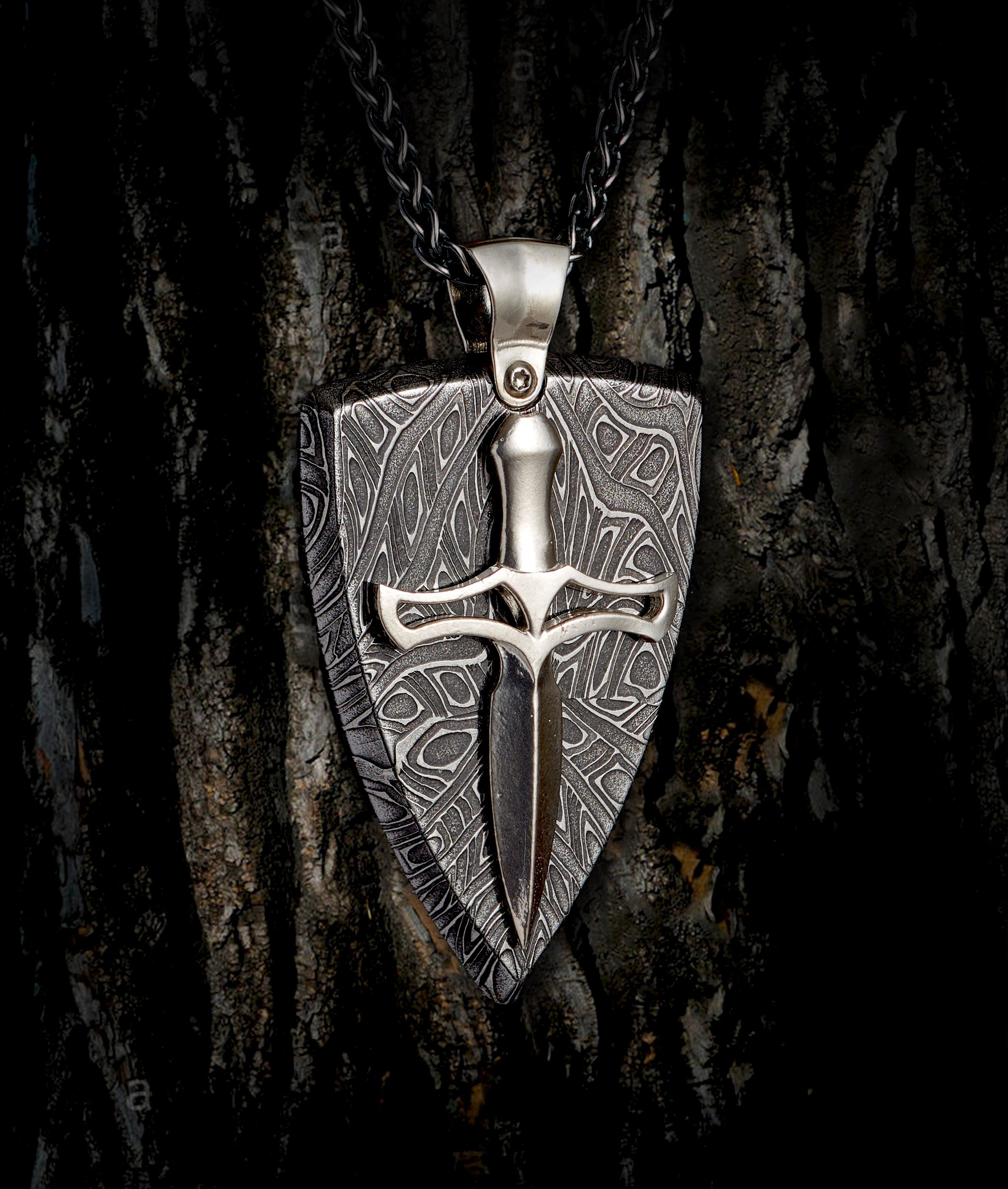 e63c6d75439e Hand-forged damascus steel  shield  pendant with overlaid Sterling Silver  dagger. Part of the new  Pulse  collection we re releasing in June.