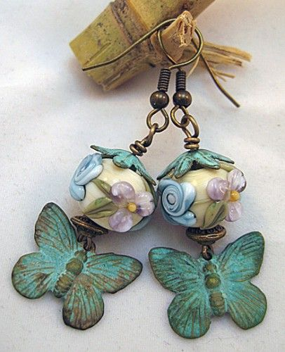 Patinaed metal has such a beautiful and aged look to it.  I love how the patinaed metal compliments the beauty of these stunning floral beads by Heather of Blissful Garden Beads.  I'm SO ready for spring!  http://www.artfire.com/ext/shop/studio/StringBeadStudio