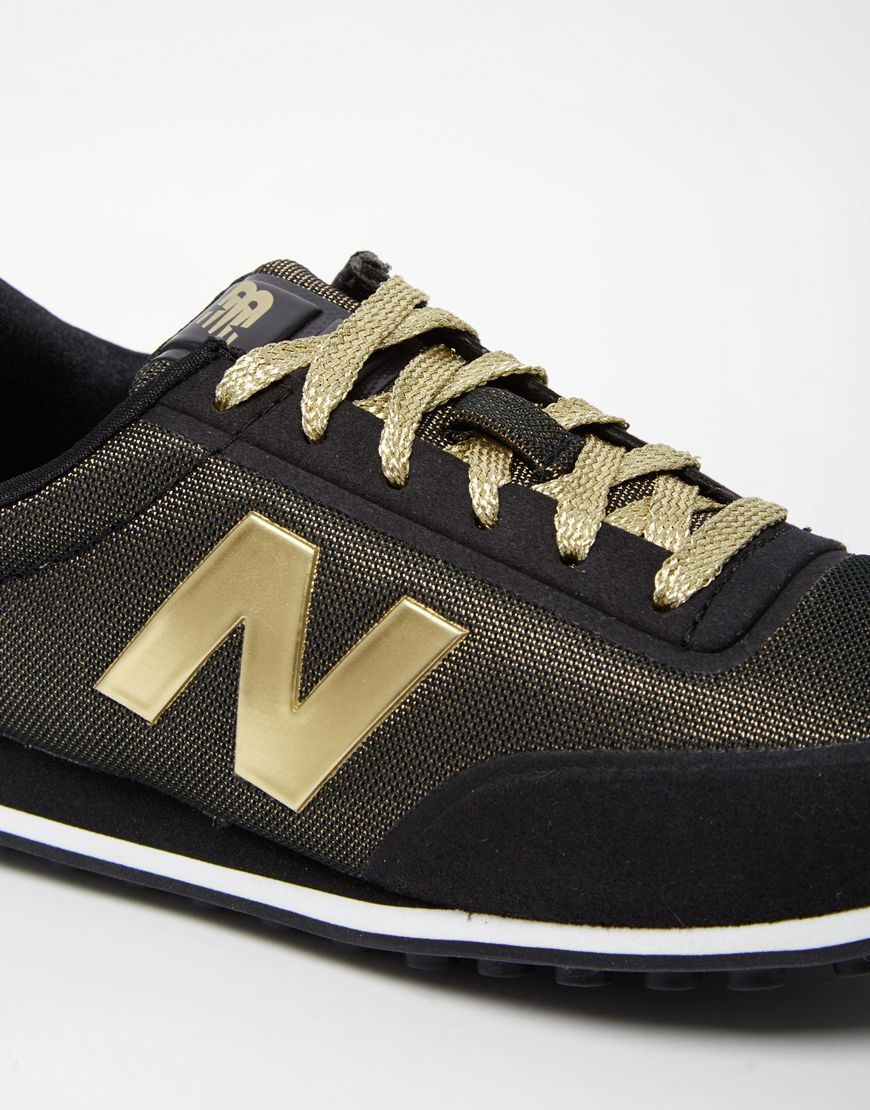f6b47260826 New Balance    410 Black   Metallic Gold Sneakers