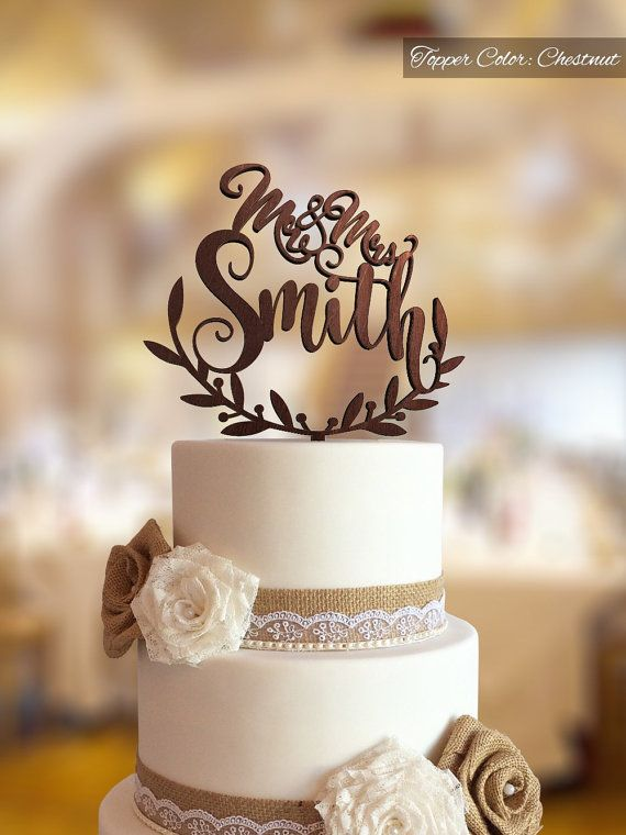 Wedding cake topper with personalized surname. Personalized