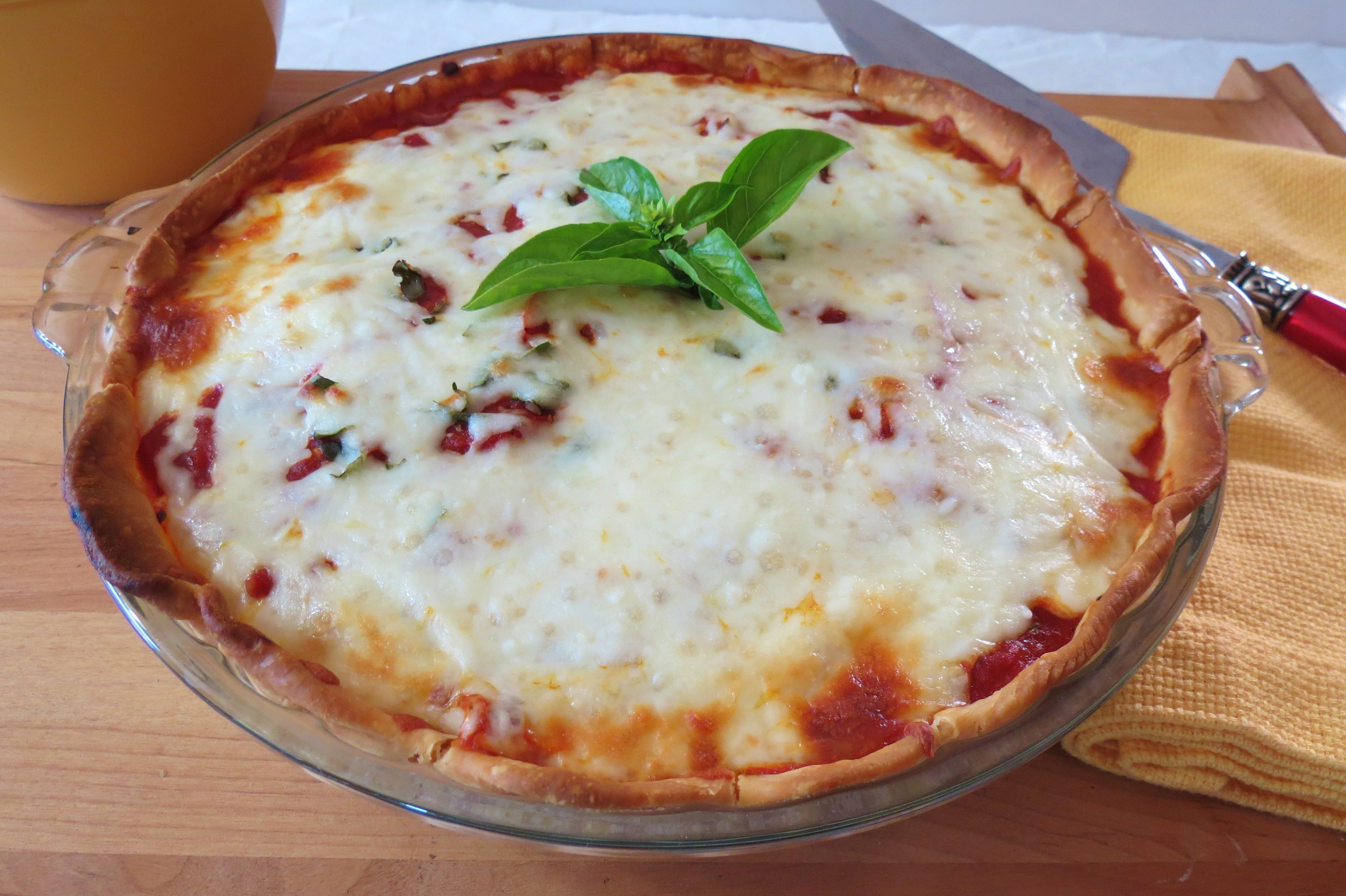 Tomato Pizza Pie - A deep dish pizza, made with fresh tomatoes and basil, topped with mozzarella cheese.