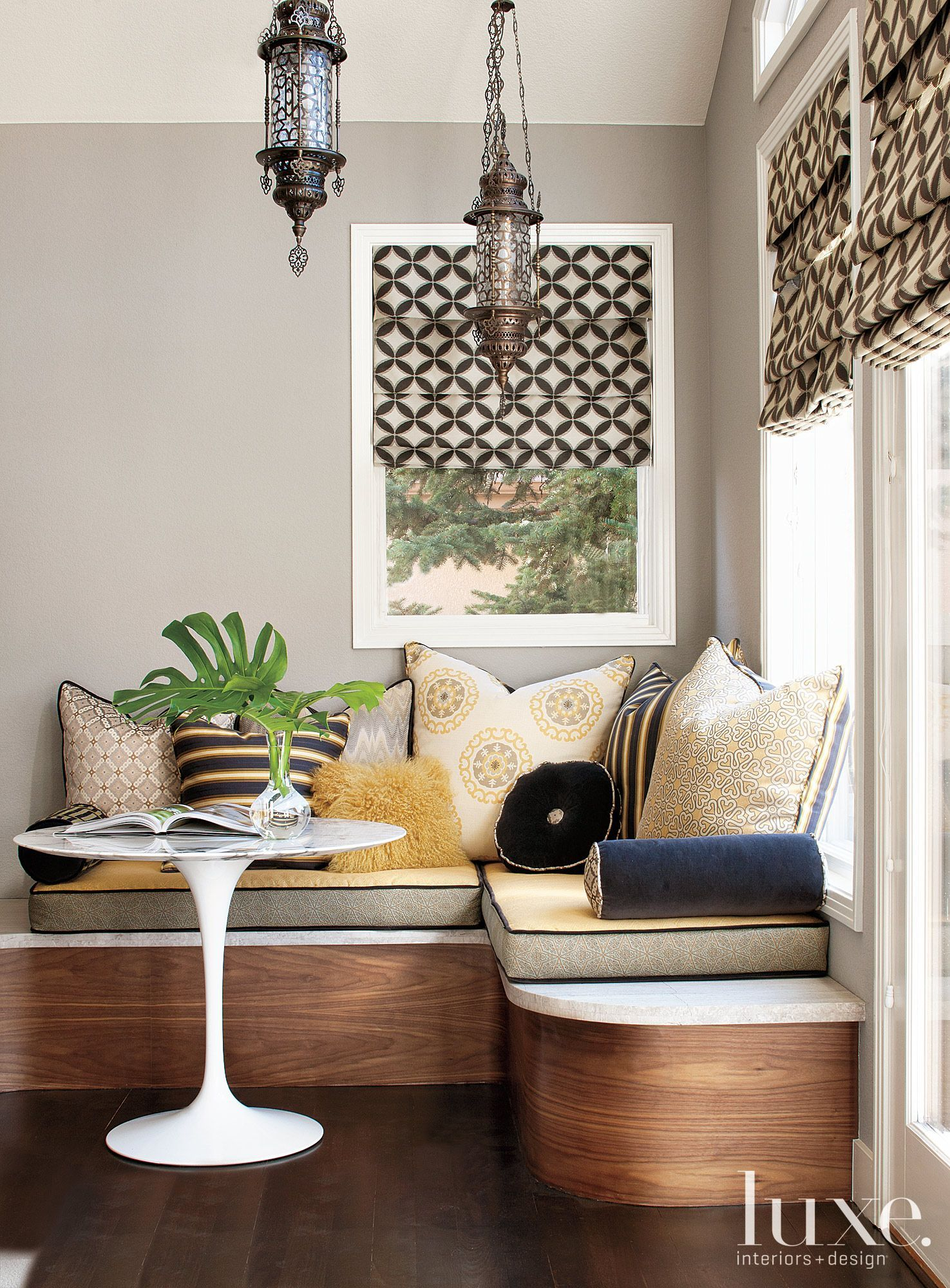 This banquette seating adds comfort and luxury to numerous ...