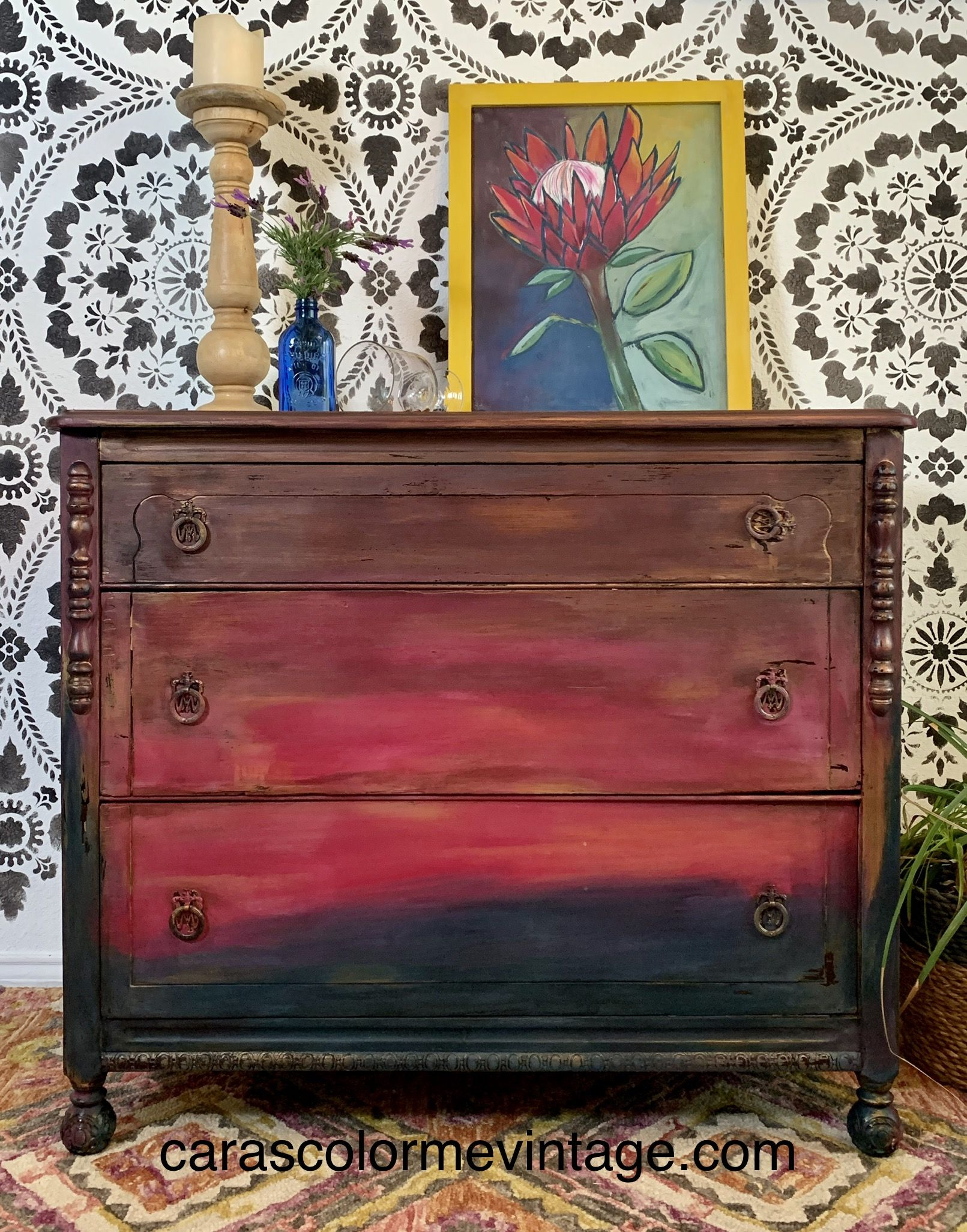 Hand painted Bohemian Fire dresser! This red and pink dresser is a DIY masterpiece. Perfect way to spruce up your home with some color and joy. DIY paint transforms this vintage dresser into a chic statement piece. #boho #bohemian #dresser #furniturerestoration #paintedfurniture #vintage #dresserforgirls #blending #sunset #pretty #stylish