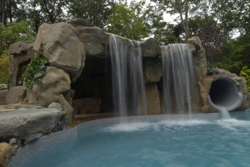 Waterfalls For Pools Slide And Big Waterfall Stone Design Flintstone Feel Pool Slide For Kids Spacious Cave Gr Pool Waterfall Outdoor Water Features Stone Pool