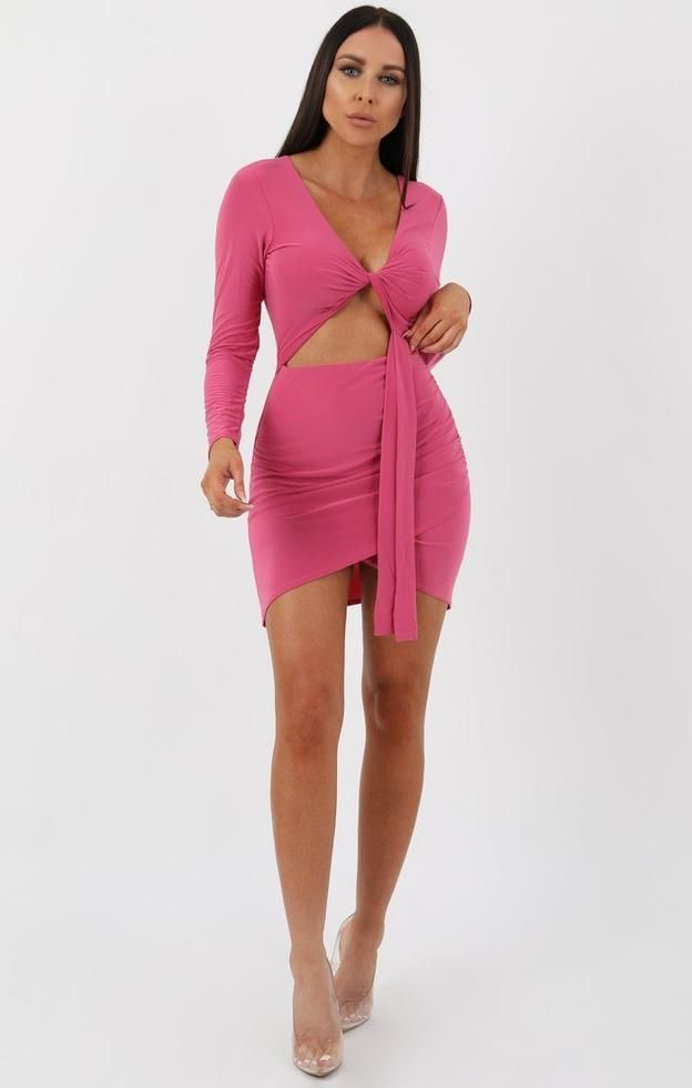 0f71fa00b7 Our Rose Long Sleeve Cut out Knot Bodycon Dress is a must have this holiday  season. Team it with some strappy heels for a look we re loving.