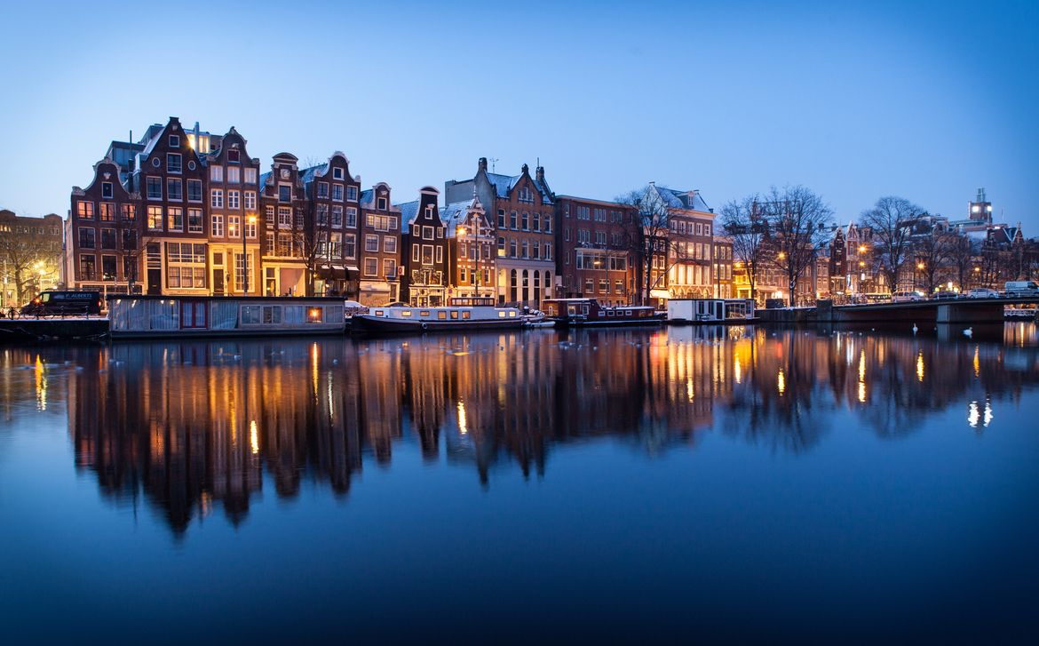 Sunrise in Amsterdam Central by Markus Gebauer Photography on 500px