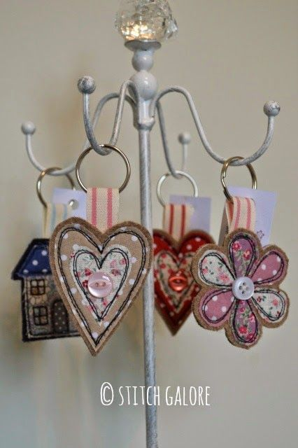 Handmade key rings decorated with applique and freehand machine embroidery.   By Stitch Galore