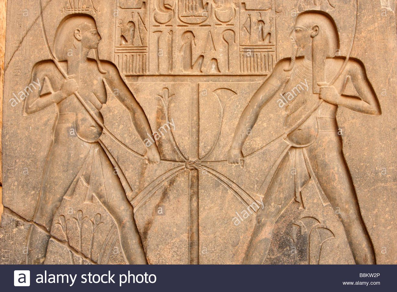 Two figures of god hapi representing upper and lower egypt tying two figures of god hapi representing upper and lower egypt tying lotus and papyrus around nile wall relief detail luxor temple izmirmasajfo