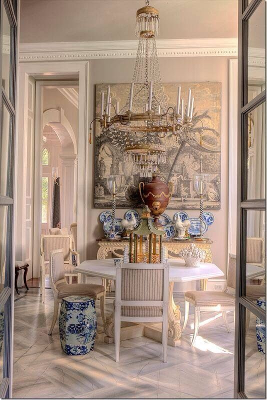 A Grandiose Chandelier Hangs Above White Dining Table In This Asian Inspired Room