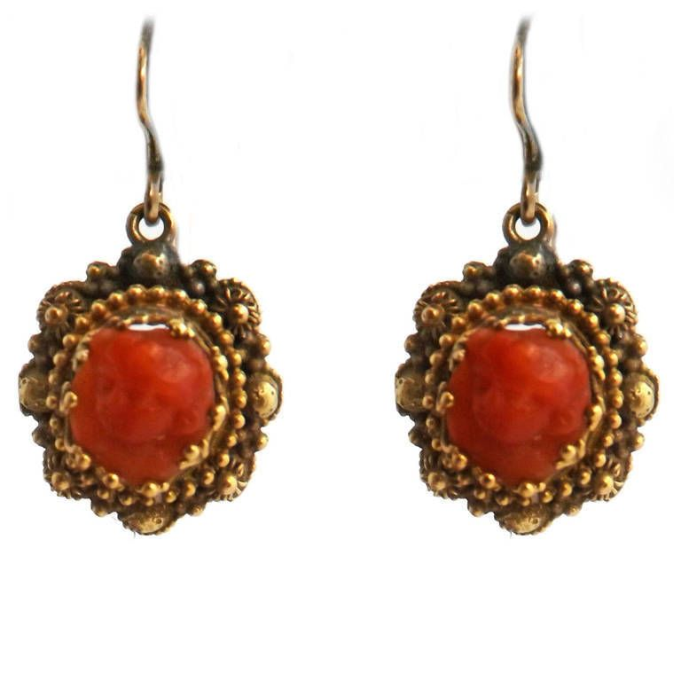 Victorian Cameo Coral Gold Earrings. Victorian Etruscan Revival 18 karat, yellow gold and coral cameo earrings, ca 1875. These earrings demonstrate the intricate beaded Etruscan Revival design with antique coral carved cameos depicting faces of females. c 1875