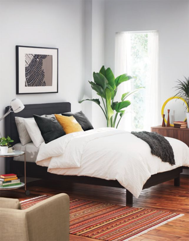 A bright bedroom with a OPPLAND queen bed frame | Decor: Master ...