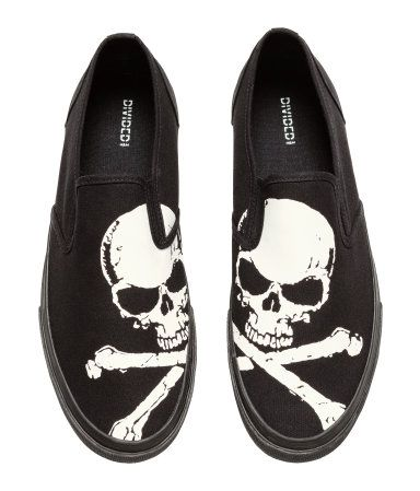 98072bcc5d Slip-on cotton canvas sneakers in black with a white printed skull design  at front.