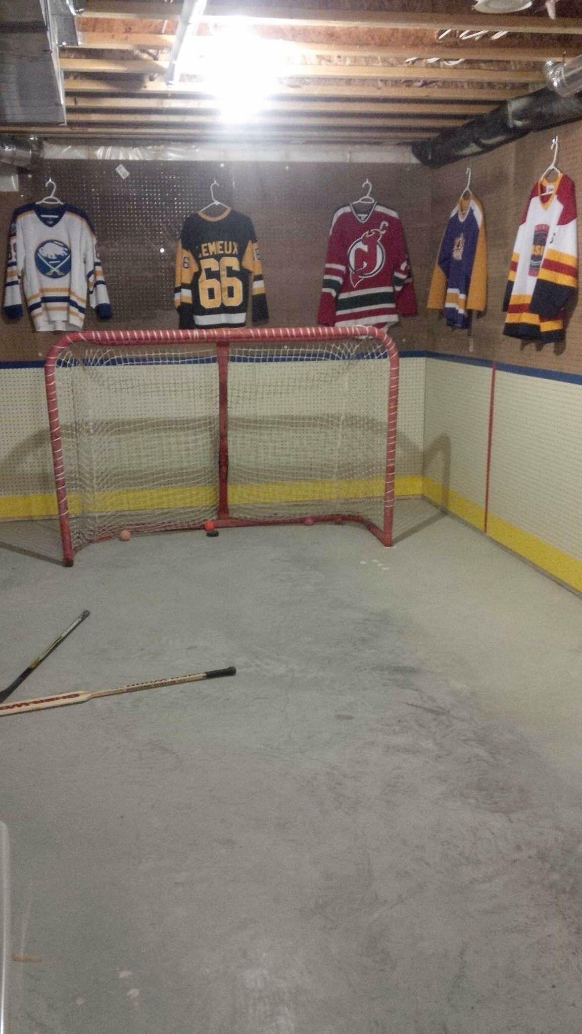 basement transformed into an indoor hockey rink love it