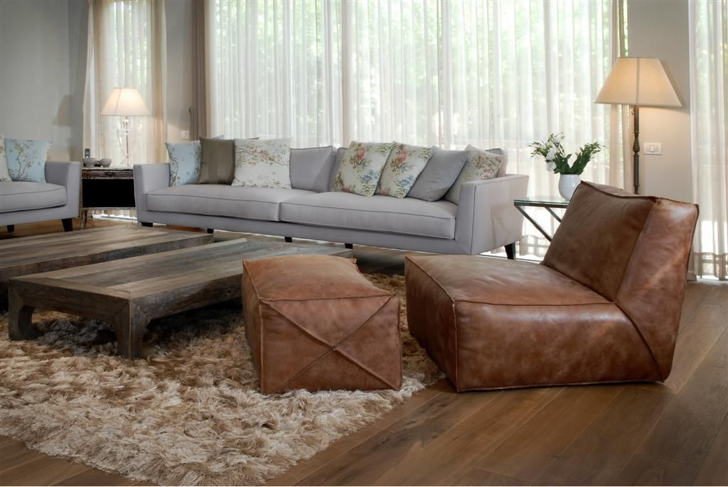 Country Style Home With Light Grey Sofa And Relaxing Leather Chair Ottoman