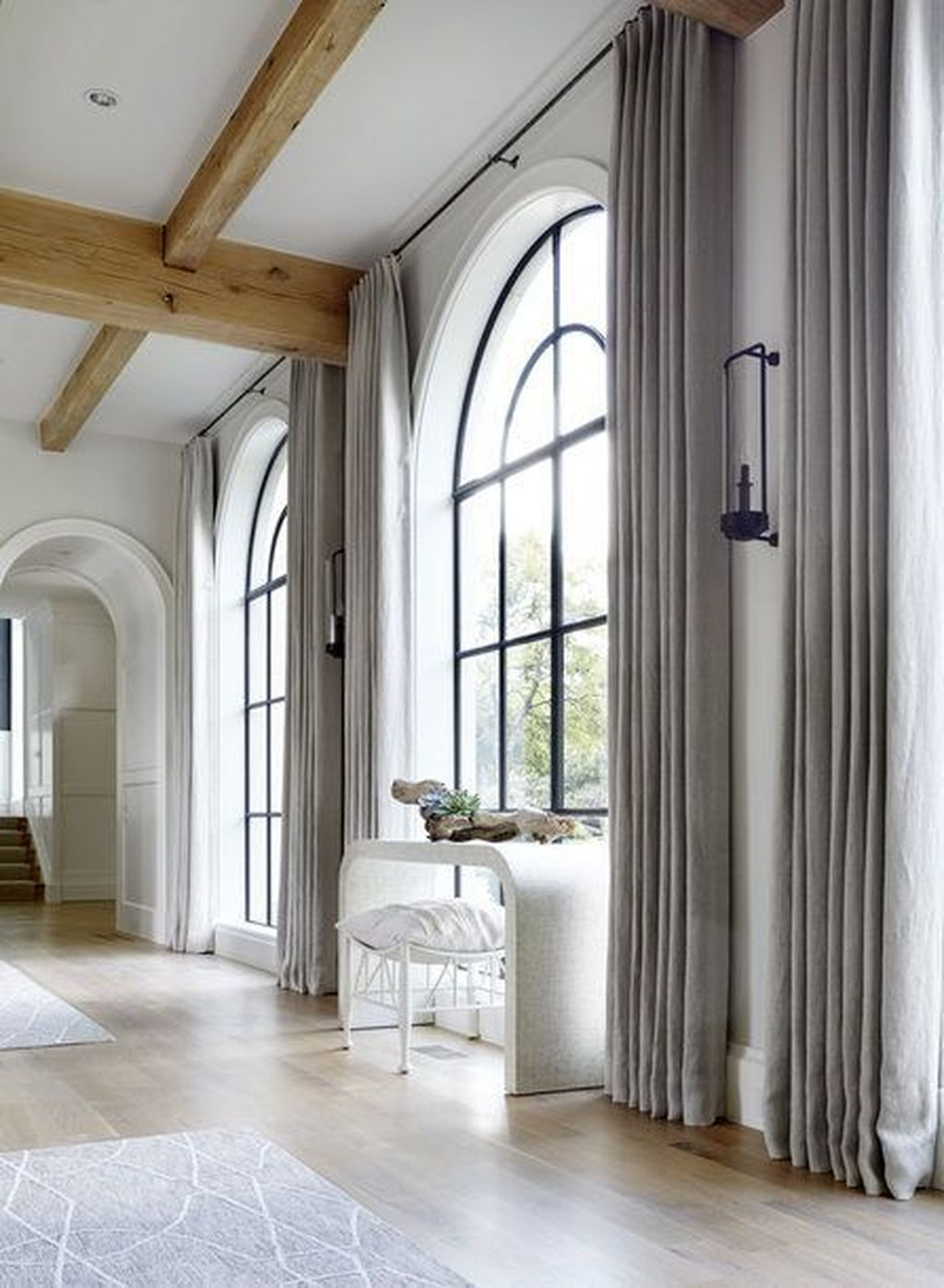 how to hang drapes over arched window