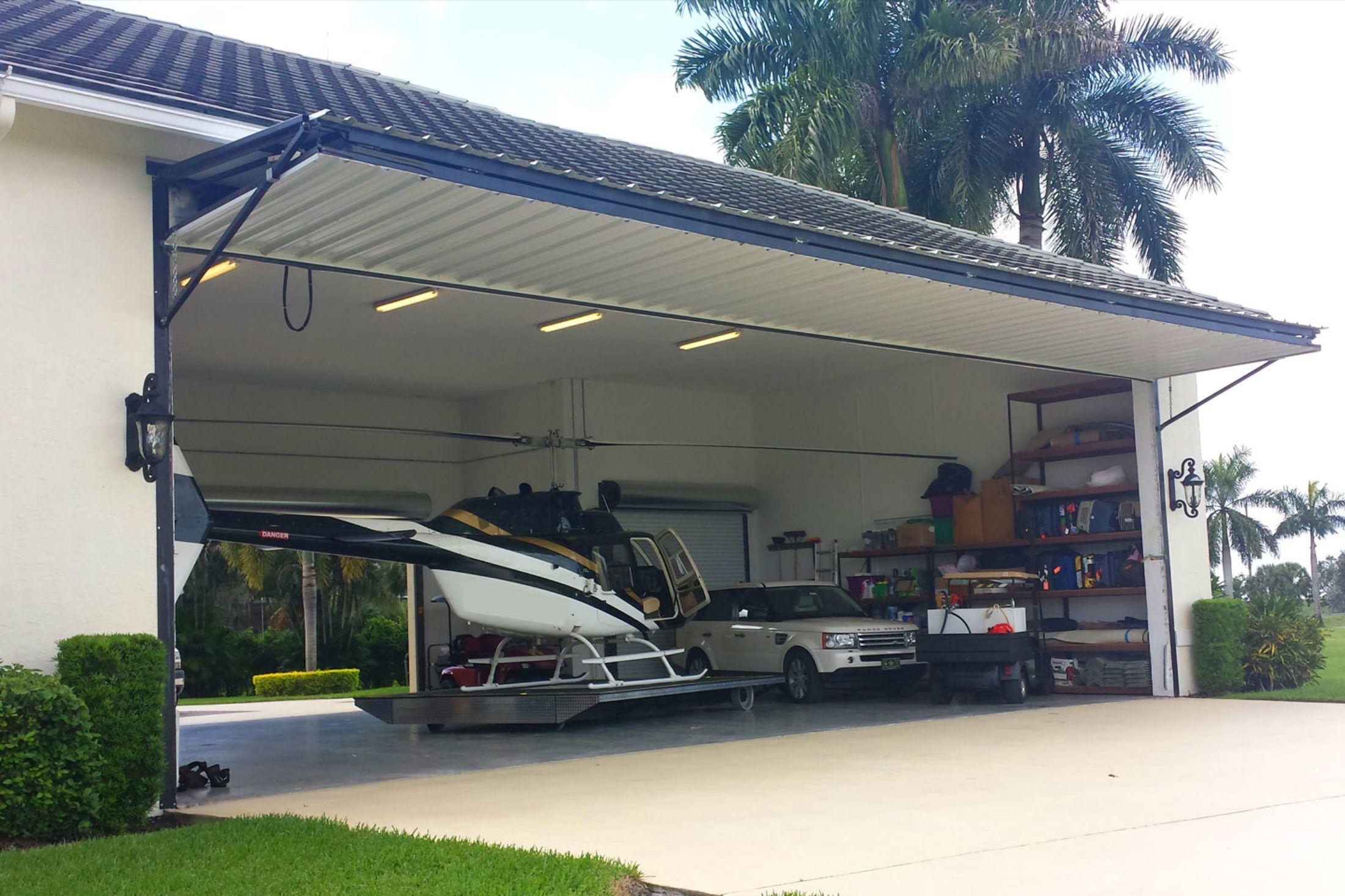 Hangar Door Bifold Hydraulic Higher Power Bottom Rolling