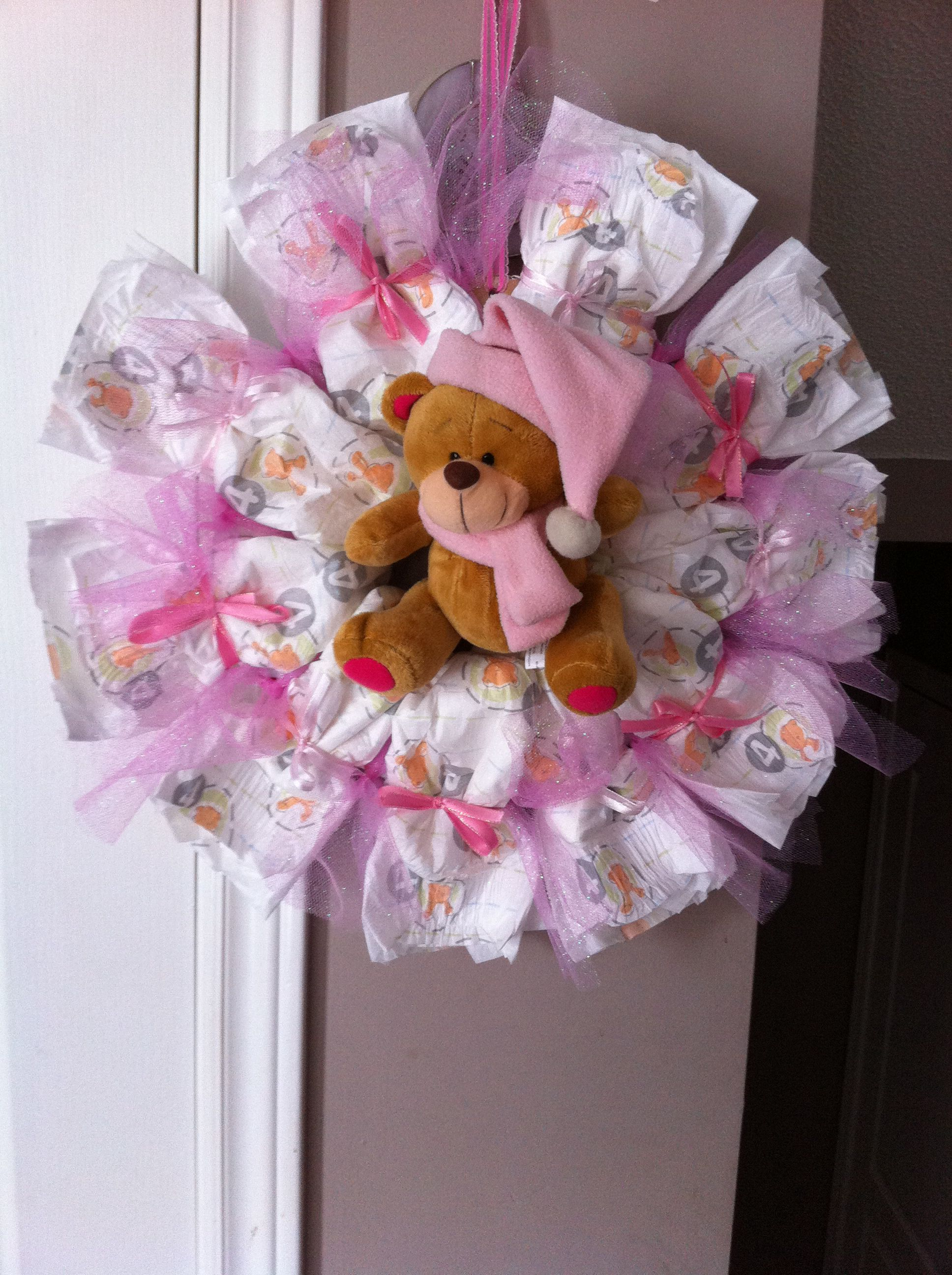 Diaper wreath. Comes with 10-20 diapers depending on size of diaper, stuffed animal or initial in the middle, ribbon.  Order one today! Text 705-716-8741 or email me at t.denardis@hotmail.ca *Choose from pink, blue, or yellow/green. *Choose your diaper size (pull-ups can be used but raises the cost).  *can be shipped within Ontario or FREE pick up in the southern part of Barrie.  PLEASE NOTE: patterns and brands are subject to change.