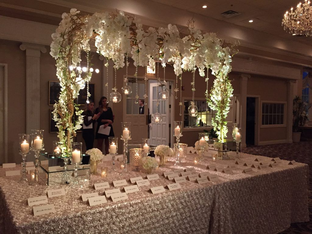 Wedding Place Card Table With Submersible Fl Inside Gl Cylinders Large Gold Dragonwood Tree Dressed Hanging Crystal And Flowers