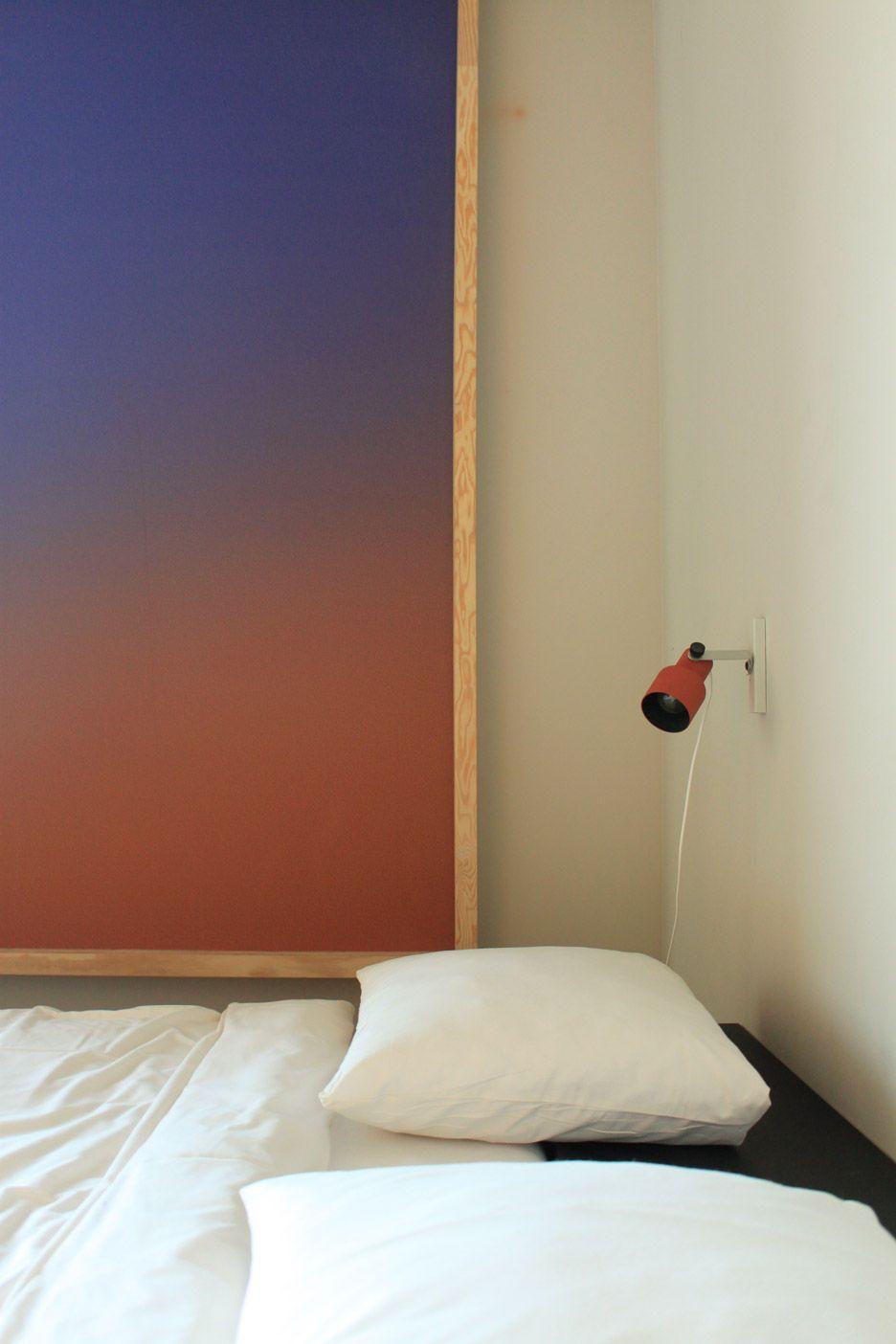 Hanna maringus volkshotel suite has a wooden bathtub and colourful