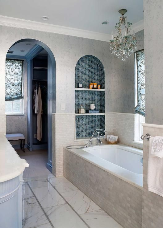 Beachy Bathroom Features A Tub Nook With Upper Walls Clad In Silver And Blue Metallic Wallpaper