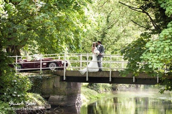 Romance on the bridge at Notley Abbey Wedding