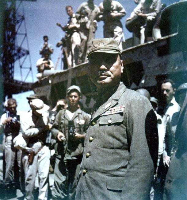 Vice Admiral Michitoro Tozuka immediately after formally surrendering the Yokosuka Naval Base to US Navy Rear Admiral Robert B. Carney, Yokosuka, Japan, 30 Aug 1945