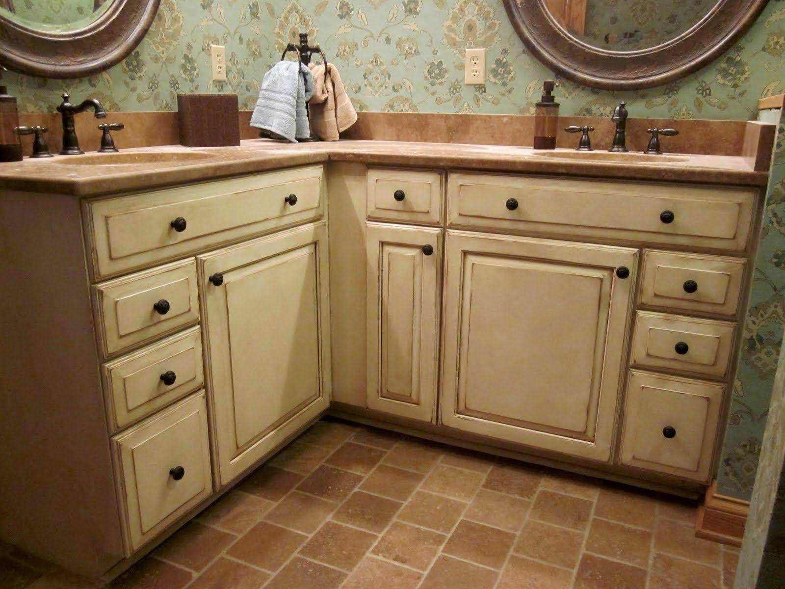 Cream kitchen cabinets with antique glaze