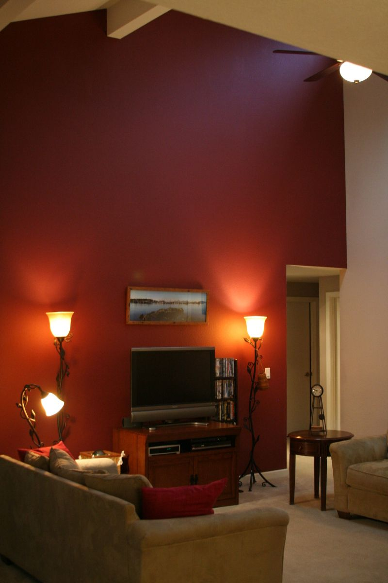 Figuring out if a burgundy accent wall on cathedral for Family room picture wall