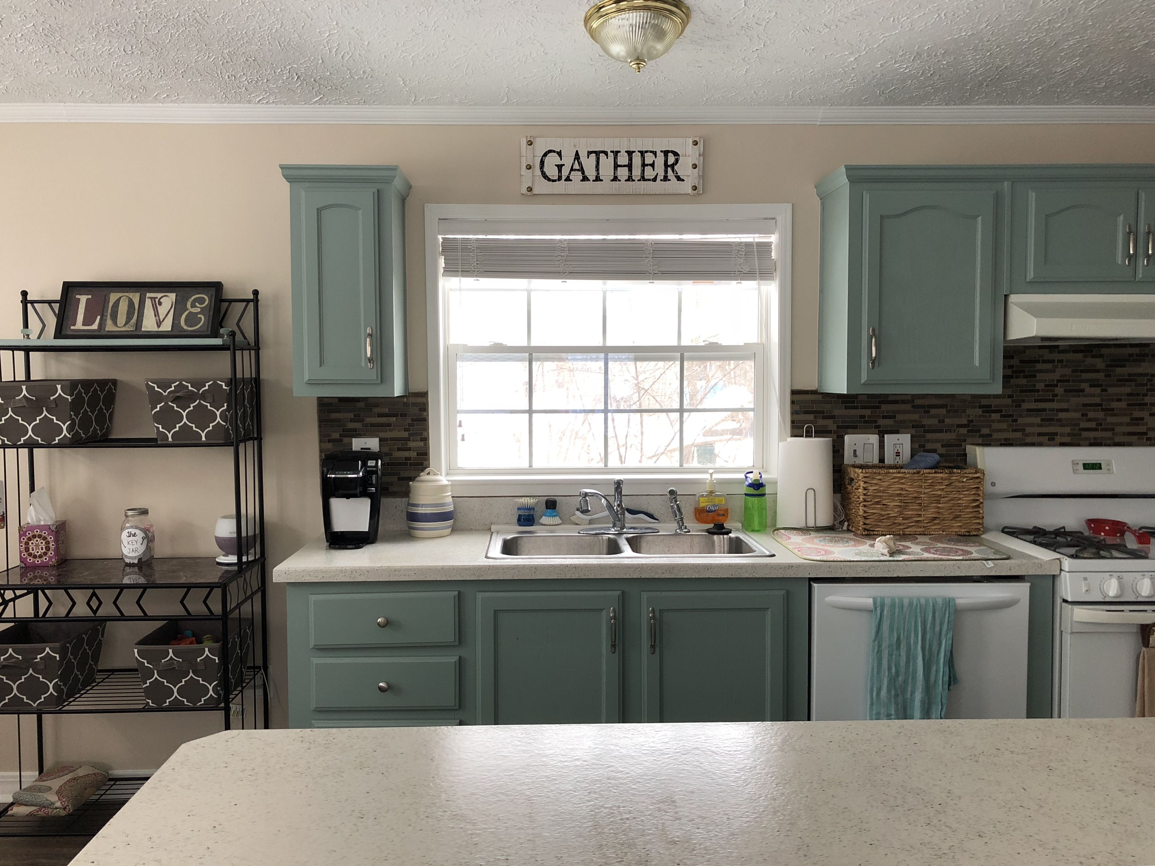 Daich spreadstone on the counters halcyon green by sherwin williams on the cupboards china doll by sherwin williams on the walls