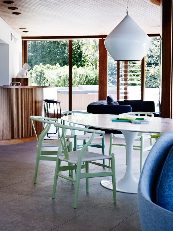 19 Dining Spaces You Would Be Proud To Have In Your Home A Beat Pendant Light By Tom Dixon Hovers Over An Oval Shaped Saarinen Table Eero