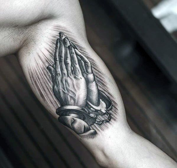 50 Of The Coolest Inner Arm Tattoos For Men Praying Hands Tattoo Tattoos For Guys Bicep Tattoo